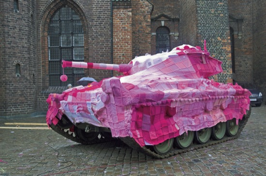 COPENHAGEN, DENMARK: A knitted cover for a tank.   A new art form involves the unlikely pairing of activism... and knitting. Urban artists are responsible for putting brightly-coloured wolllen blankets on street signs, railings and buildings in cities across the world to make a statement. The art form is called knit graffiti or guerilla knitting and began in Texas in 2005. Now a new book full of guerilla knitting patterns inspired by the works called Yarn Bombing has just been released.  PHOTOGRAPHY BY Jeff Christenson / Arsenal Pulp Press / BARCROFT MEDIA LTD  UK Office, London. T +44 845 370 2233 W www.barcroftmedia.com  Australasian & Pacific Rim Office, Melbourne. E info@barcroftpacific.com T +613 9510 3188 or +613 9510 0688 W www.barcroftpacific.com  Indian Office, Delhi. T +91 997 1133 889 W www.barcroftindia.com